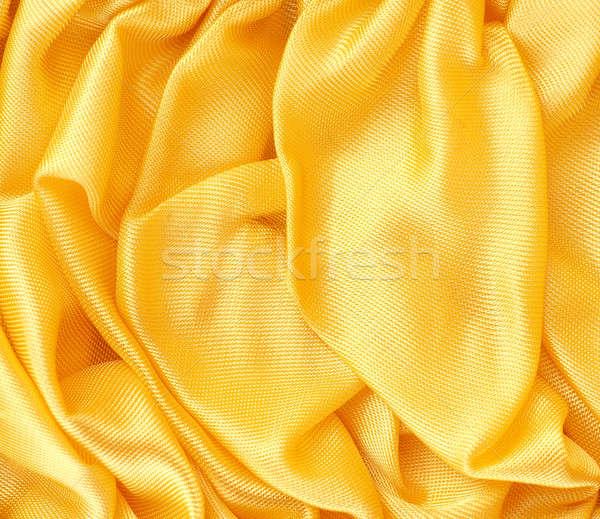 Złoty satyna tekstury tkaniny przestrzeni tekst Zdjęcia stock © andreasberheide