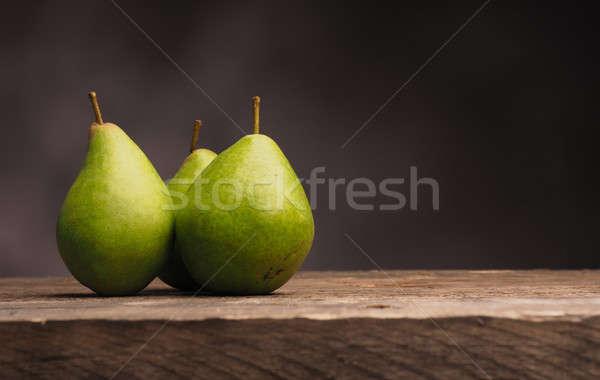 Three pears on wood Stock photo © andreasberheide