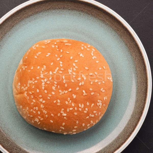 Sesame bun on a rustic plate Stock photo © andreasberheide