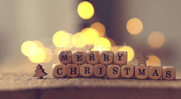 Vidám karácsony karácsonyi üdvözlet szavak fa asztal elmosódott Stock fotó © andreasberheide