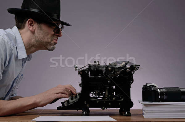 Agent with an old type writer and a vintage camera Stock photo © andreasberheide