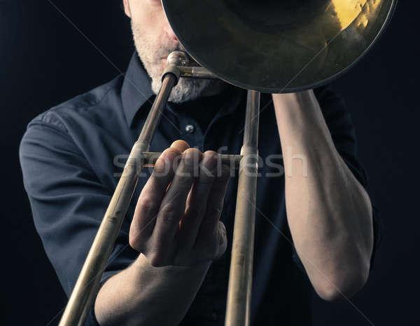 Playing trombone, close up shot Stock photo © andreasberheide