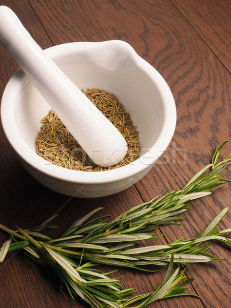 Rosemary with a white mortar and pestle Stock photo © andreasberheide