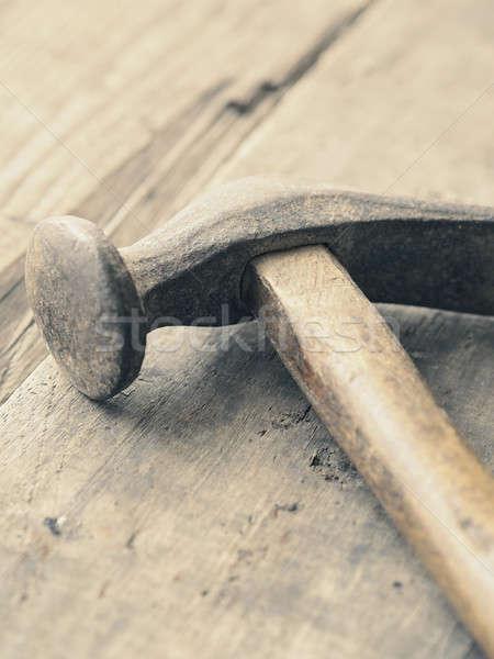 Old used hammer on wood Stock photo © andreasberheide