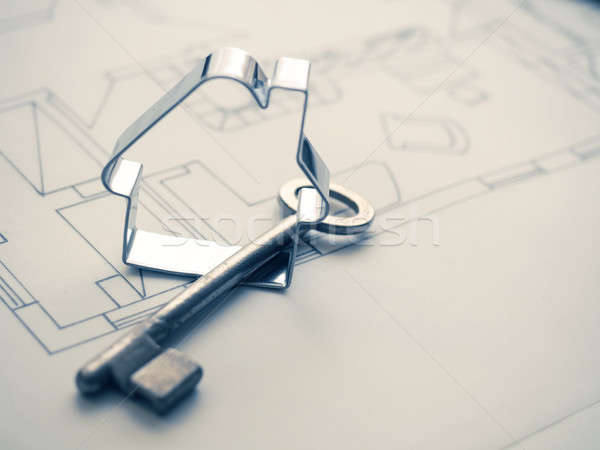House shape with a key on construction plan Stock photo © andreasberheide