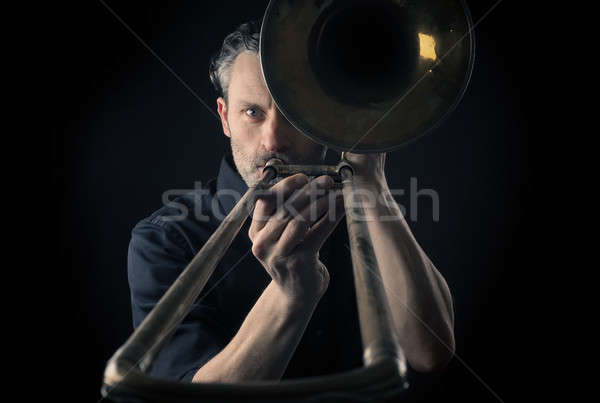 Musician with a trombone Stock photo © andreasberheide