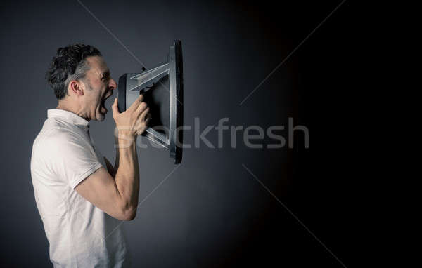 Man screaming with a speaker Stock photo © andreasberheide