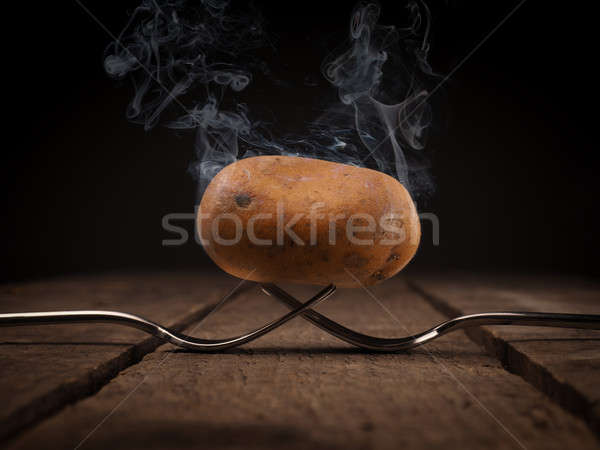 Hot potato on forks Stock photo © andreasberheide