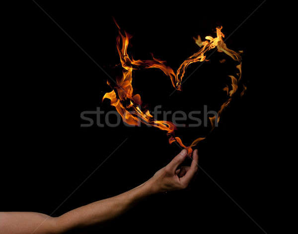 Hand with heart shaped flames Stock photo © andreasberheide