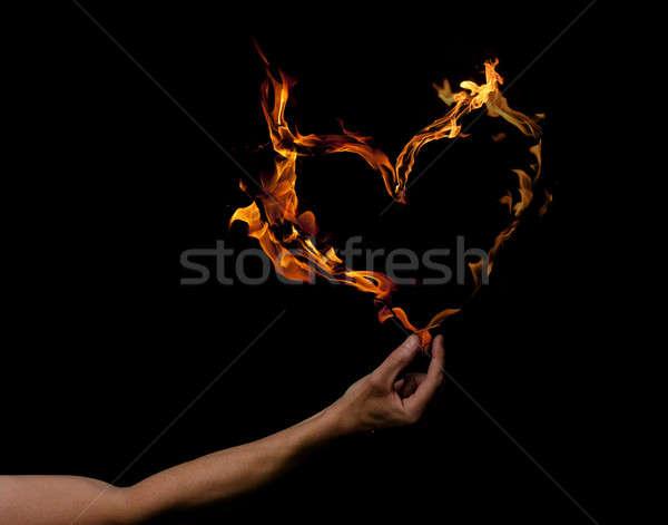 Kéz szív alakú lángok tart sötét Stock fotó © andreasberheide