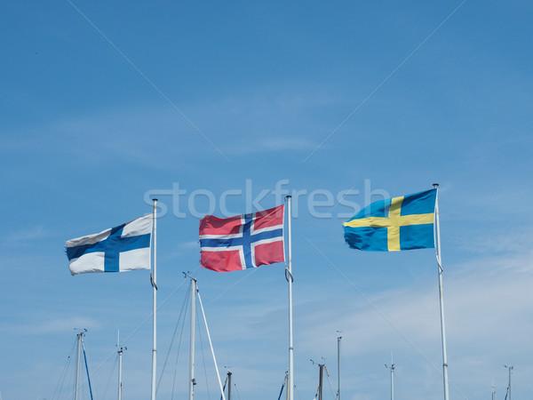 Três bandeiras marina azul verão céu Foto stock © andreasberheide