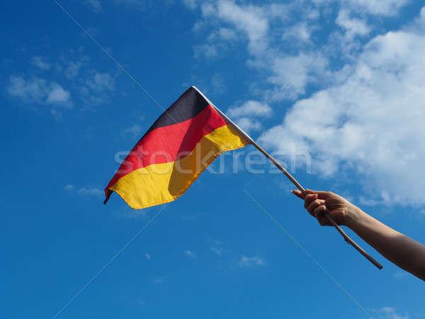 Femminile mano bandiera blu estate Foto d'archivio © andreasberheide