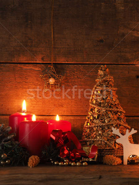 Romantic Christmas background with candle light Stock photo © andreasberheide