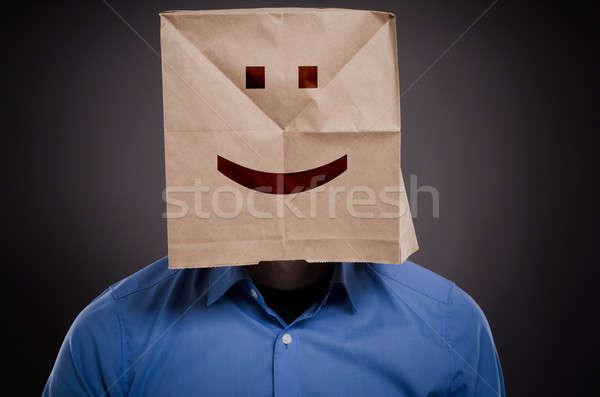 üzletember mosolygós arc papírzacskó gondolkodik pozitív kép Stock fotó © andreasberheide