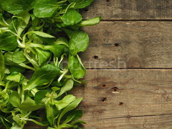 Mache on a wooden table Stock photo © andreasberheide