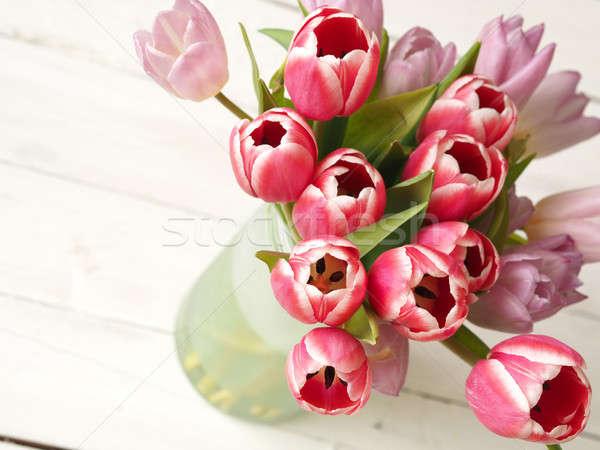 Bunch of tulips on wood Stock photo © andreasberheide