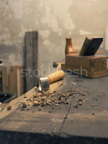 Carpenter tools on a wooden workbench Stock photo © andreasberheide