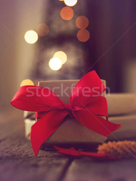 Christmas present with blurred lights Stock photo © andreasberheide