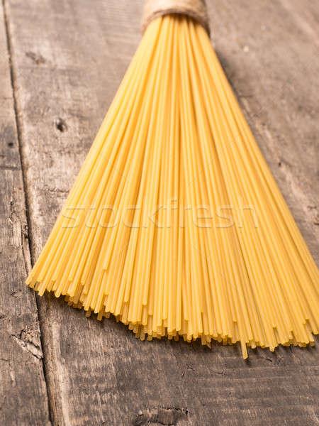 Spaghetti on a rustic wooden table Stock photo © andreasberheide