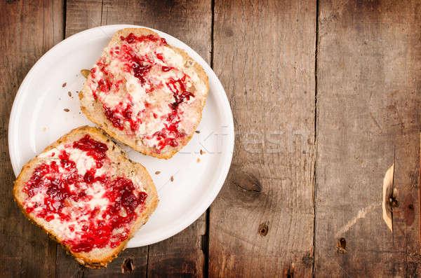 Raspberry jam on whole grain rolls Stock photo © andreasberheide