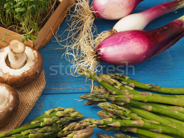 Organic vegetables on a wooden table Stock photo © andreasberheide