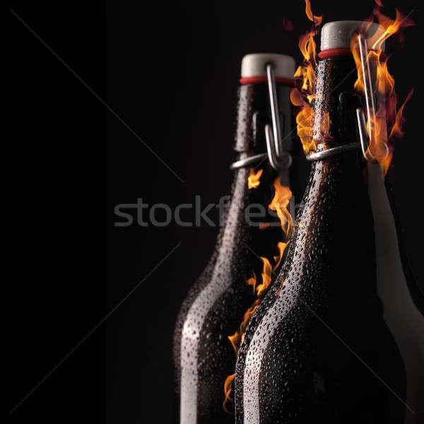 Bottiglia fiamme freddo cool gocce Foto d'archivio © andreasberheide