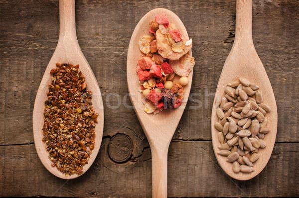 Egészséges étel fakanál három müzli mag napraforgó Stock fotó © andreasberheide