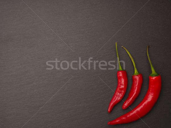 Red pepperoni on a dark slate background Stock photo © andreasberheide