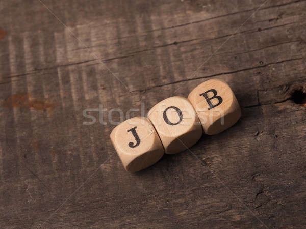 Wooden dices with the word job Stock photo © andreasberheide