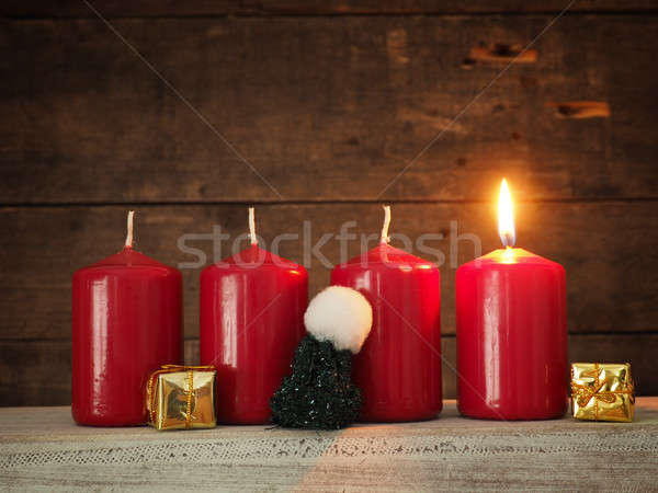 Red Advent candles on a wooden background Stock photo © andreasberheide