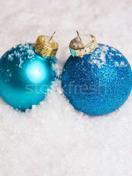 Blue Christmas baubles on snow Stock photo © andreasberheide
