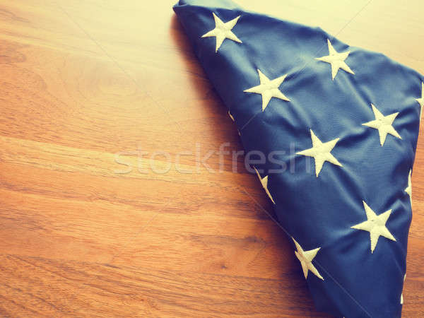 Folded American flag on a wooden table Stock photo © andreasberheide