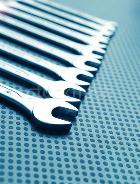 Modern industrial background with wrench assortment Stock photo © andreasberheide