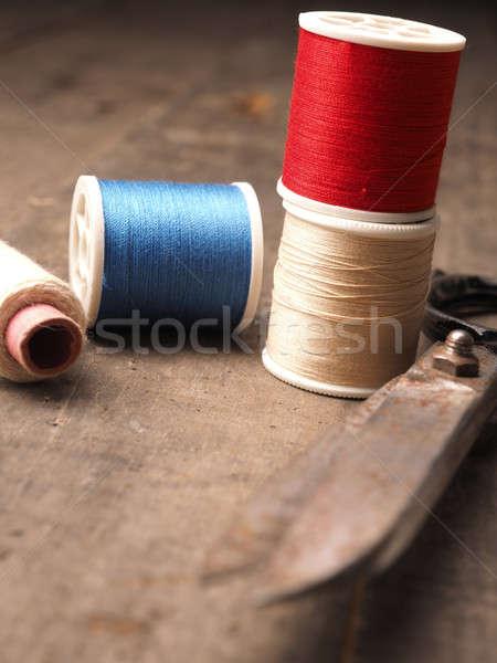 Old used sewing tools on wood Stock photo © andreasberheide