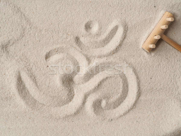 Om symbol in sand Stock photo © andreasberheide