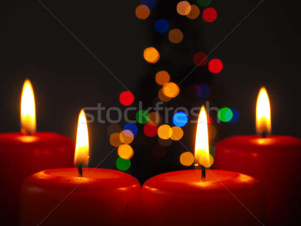 Burning Advent candles with Christmas tree lights Stock photo © andreasberheide