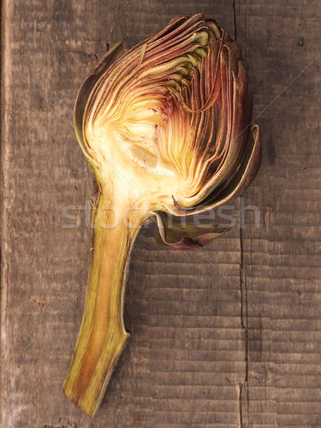 Half of an artichoke on wood Stock photo © andreasberheide