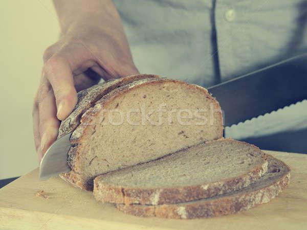 Ekmek atış adam el Stok fotoğraf © andreasberheide