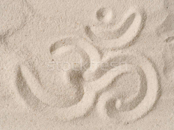 Om symbol in sand Stock photo © andreasberheide