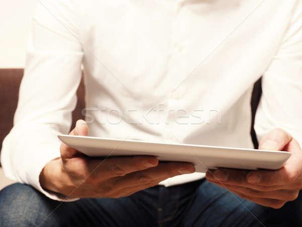 Businessman reading an ebook Stock photo © andreasberheide