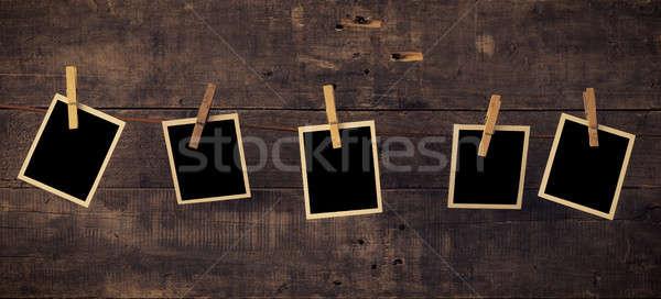 Five old photo frames on wood Stock photo © andreasberheide