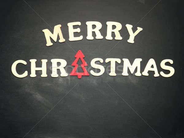 Merry Christmas on a chalkboard Stock photo © andreasberheide