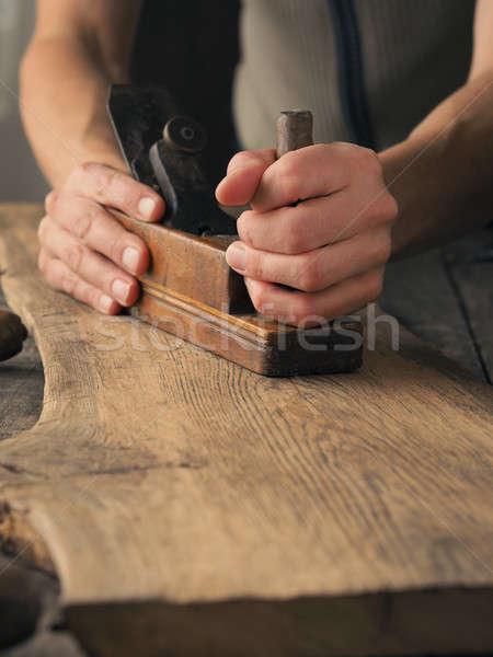 Wood working on an old plank Stock photo © andreasberheide