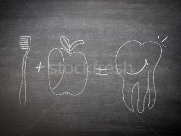 Dente cuidar lousa mão escove maçã Foto stock © andreasberheide
