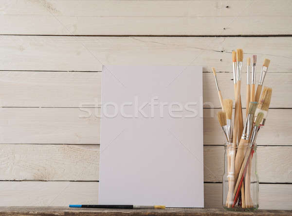 Brushes and canvas on wood Stock photo © andreasberheide