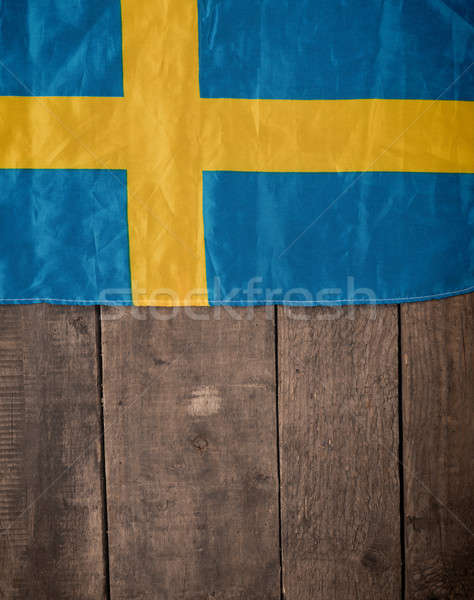 Swedish flag on wood Stock photo © andreasberheide
