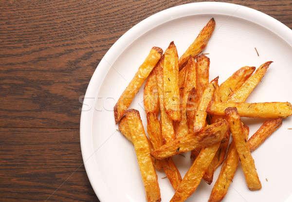 Fatto in casa patatine fritte rosmarino bianco piatto veloce Foto d'archivio © andreasberheide