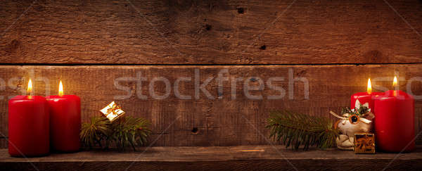 Four candles burning on rustic wood Stock photo © andreasberheide
