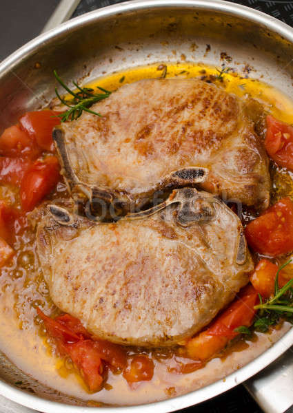 Pork chop with herbs Stock photo © andreasberheide