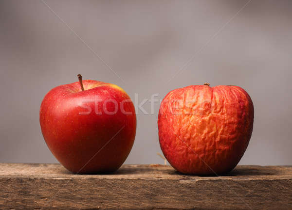 Stock photo: Two red apples on table
